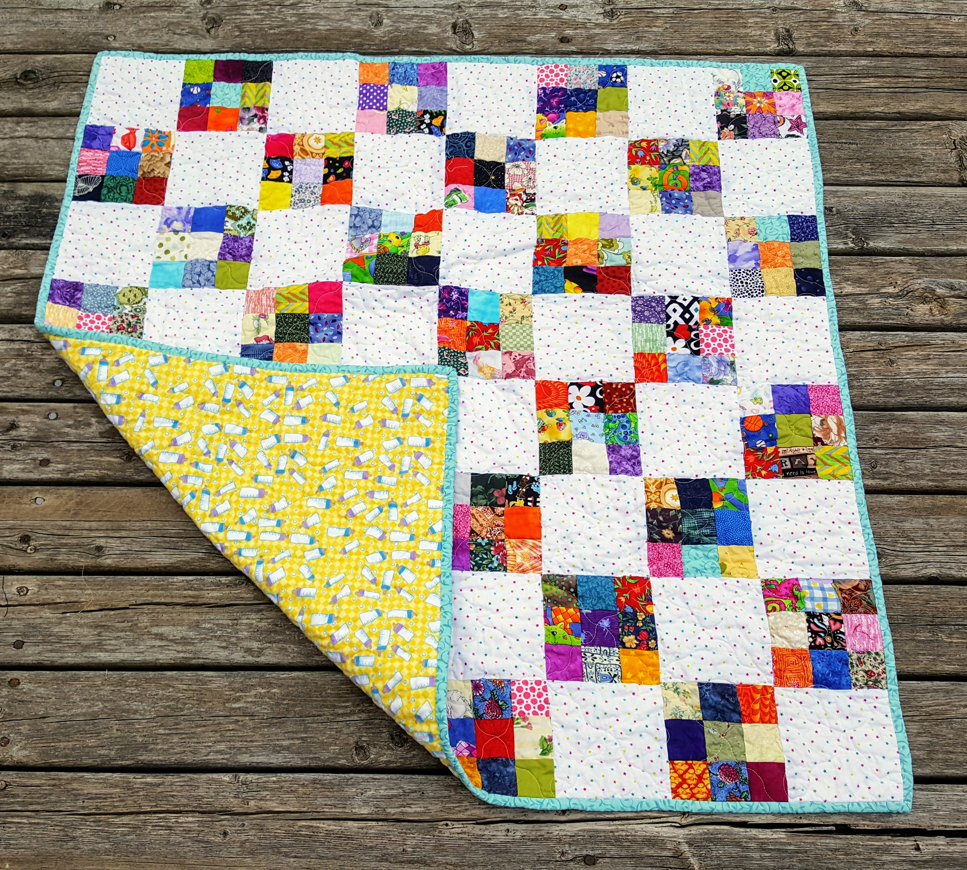 9 patch baby quilt with flannel backing