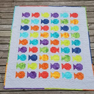 fish quilt with scrappy binding