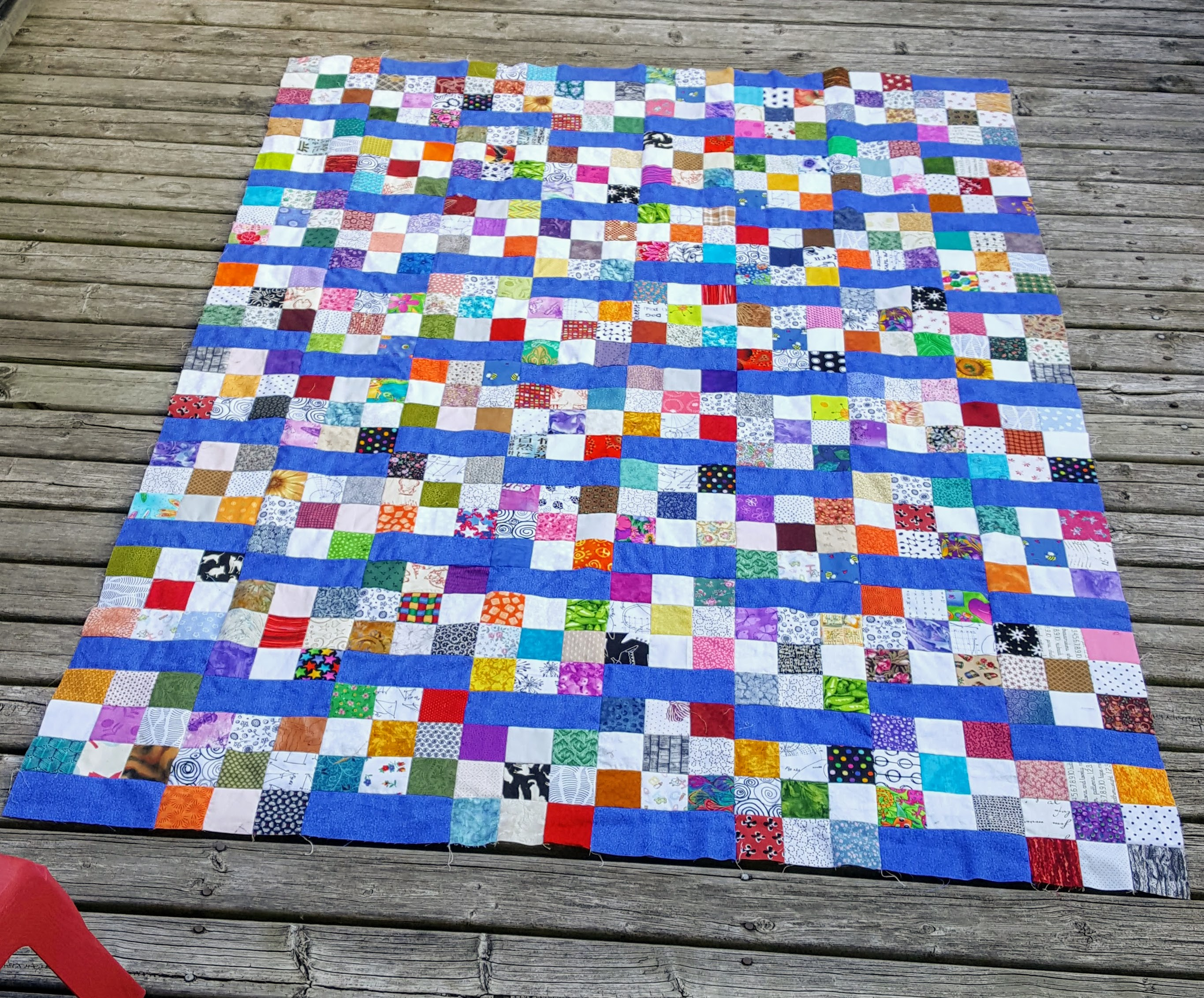 uneven 9 patch quilt top with broken stripes