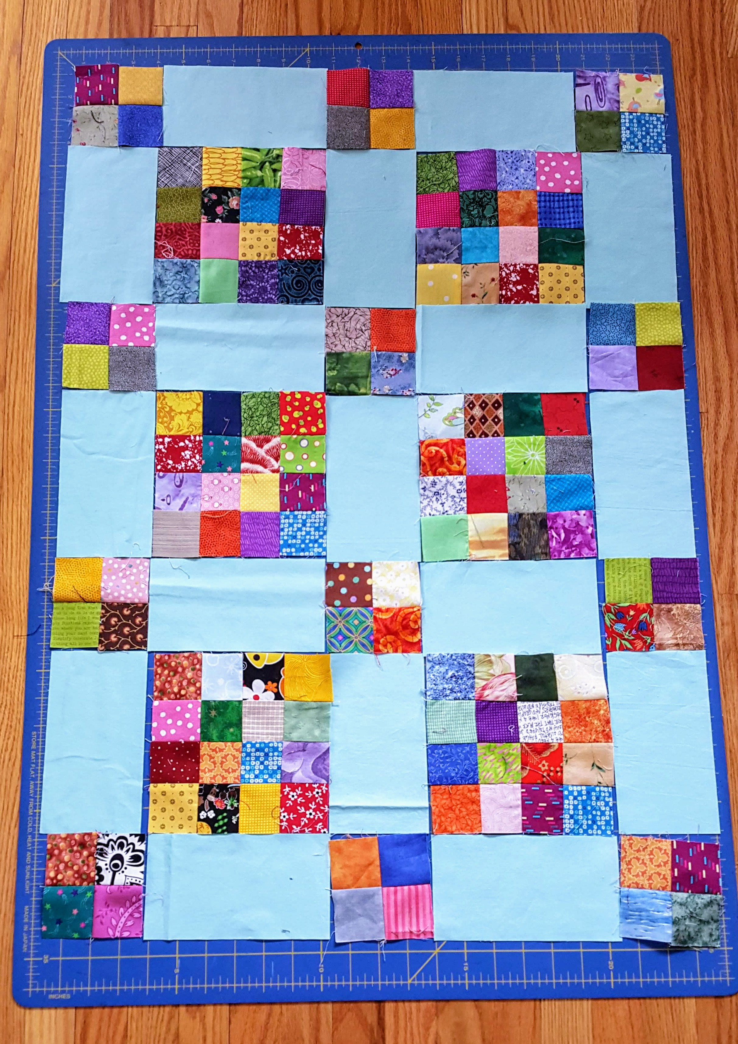 16 patches, 4 patches and sashing. Quilt layout audition. scrappy quilt