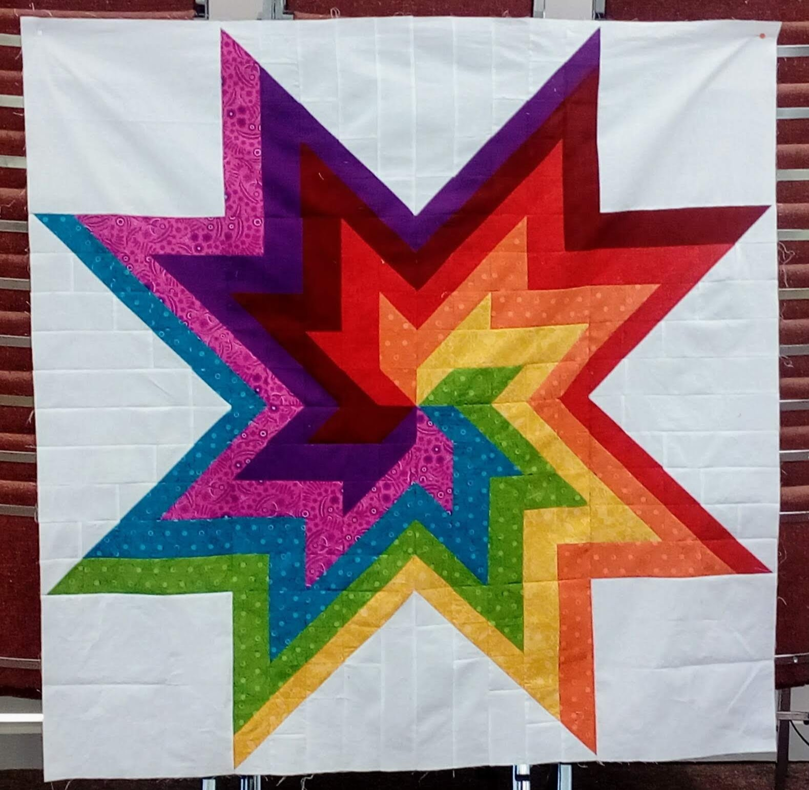 rainbow swirl quilt top