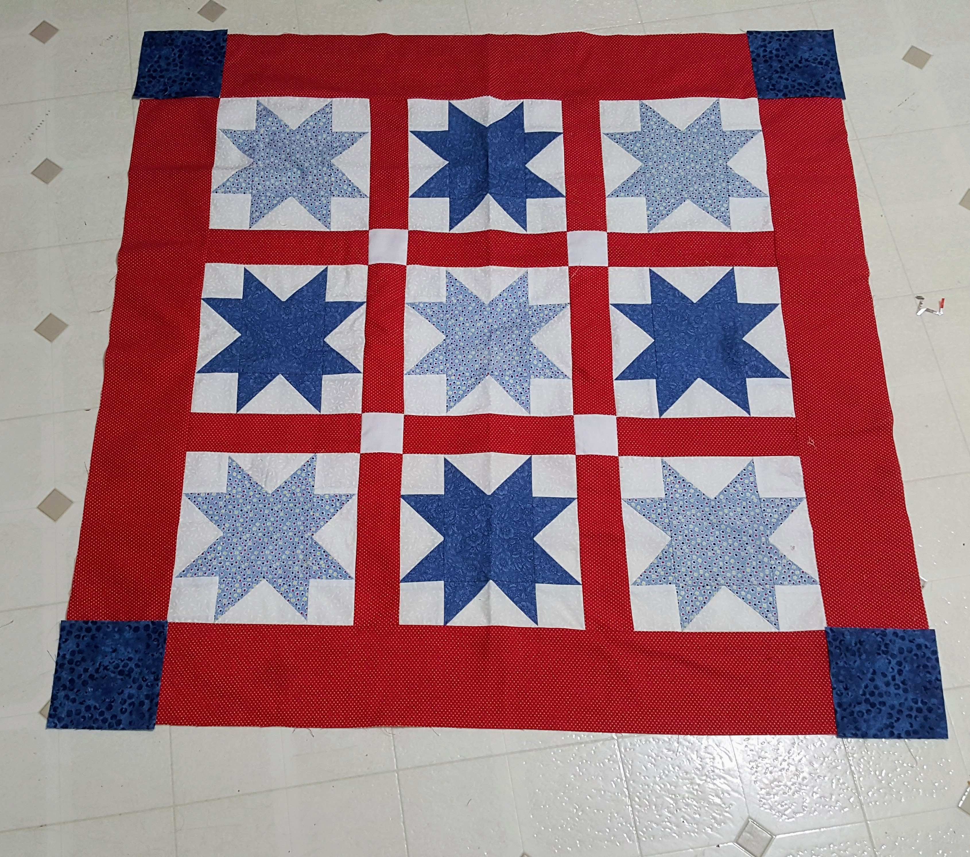 Blue sawtooth star baby quilt top
