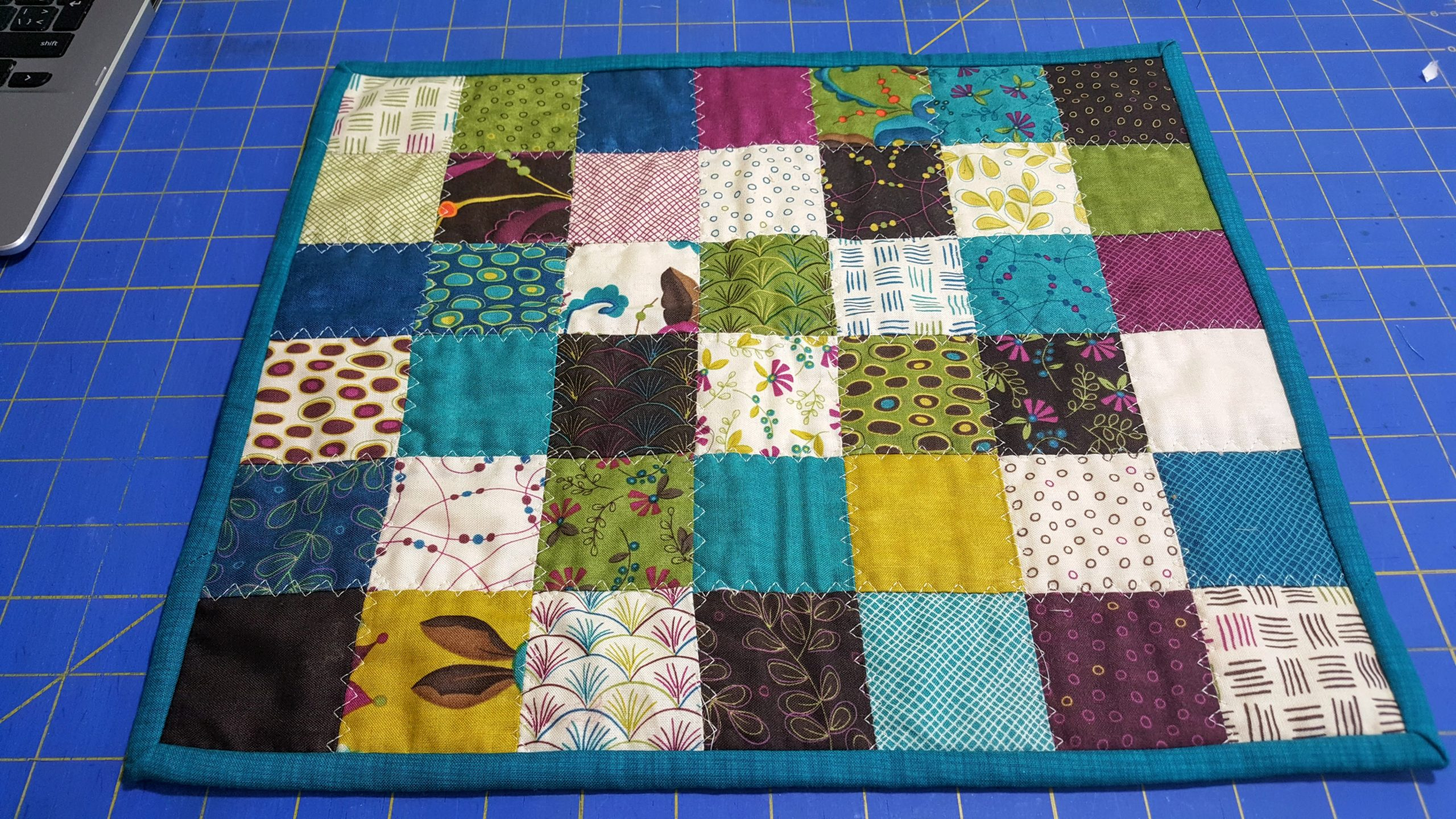 "small mat made from 2.5"" quilt squares"
