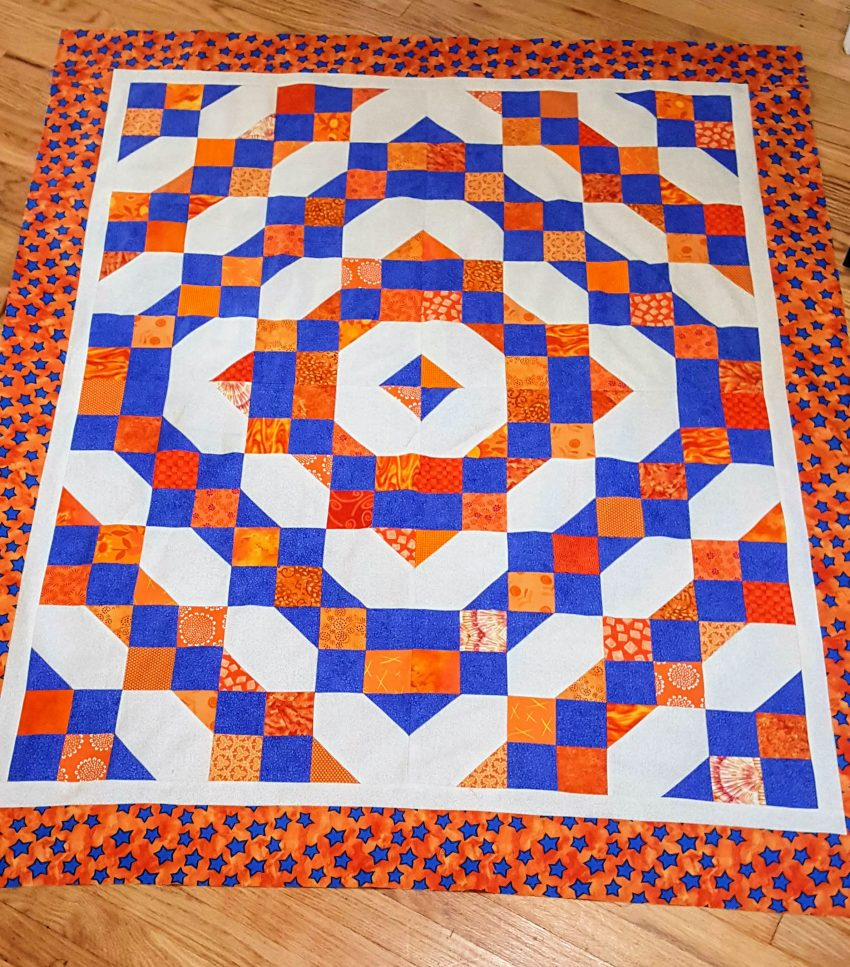orange and blue quilt top