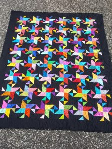 star struck quilt in black and brights