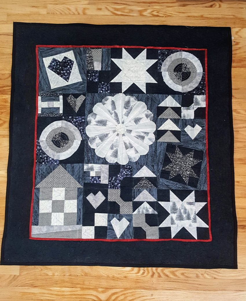 black and grey sampler quilt