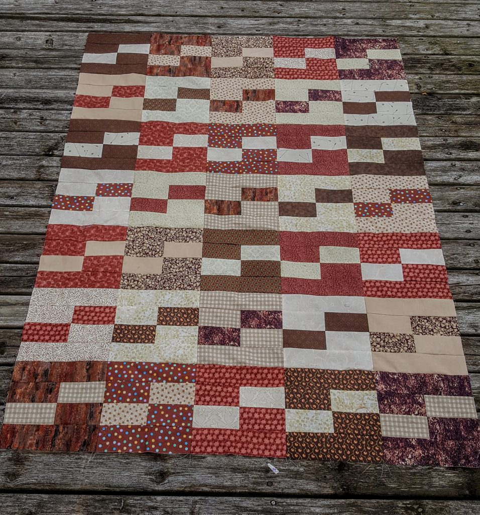 Making a dent in my brown and beige stash with this scrappy quilt