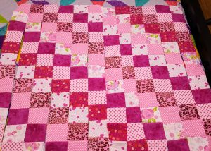 Rows of pink flannel quilt squares