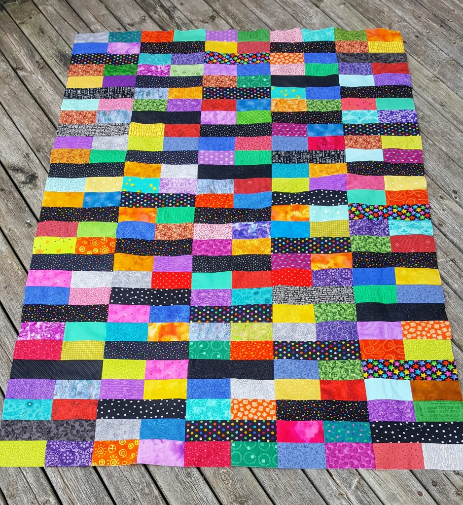 colorful bricks and sticks quilt top