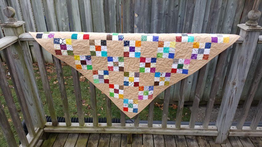 scrappy beige nine patch quilt