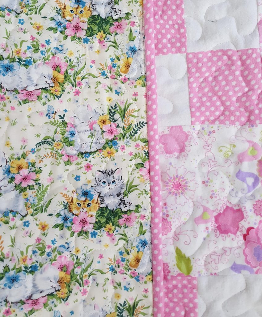 Dotty Flower Flannel Quilt showing backing