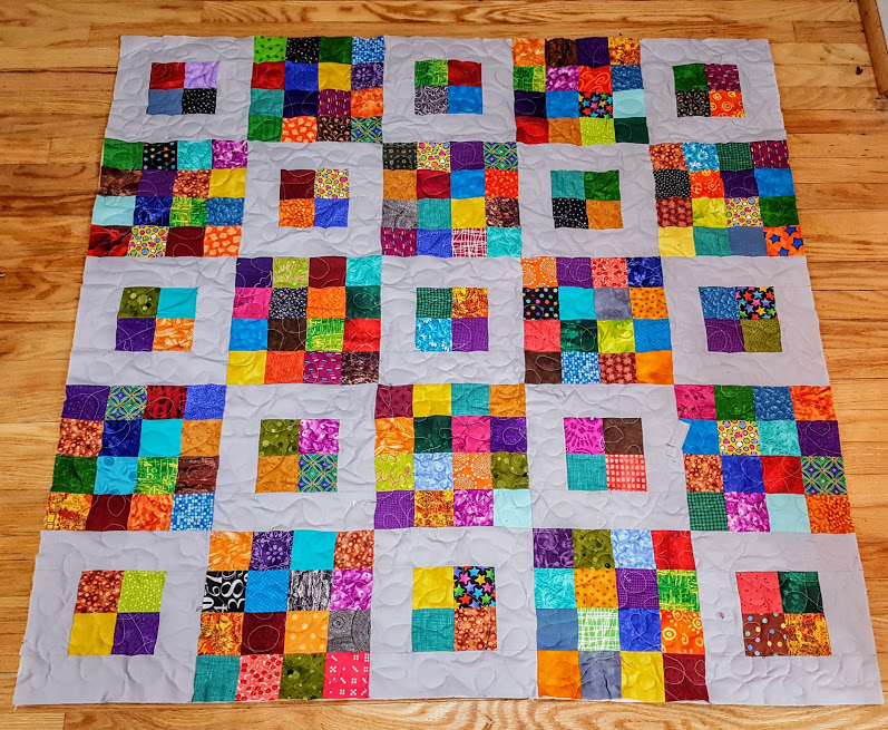 4 patch and 16 patch blocks make up this quilt