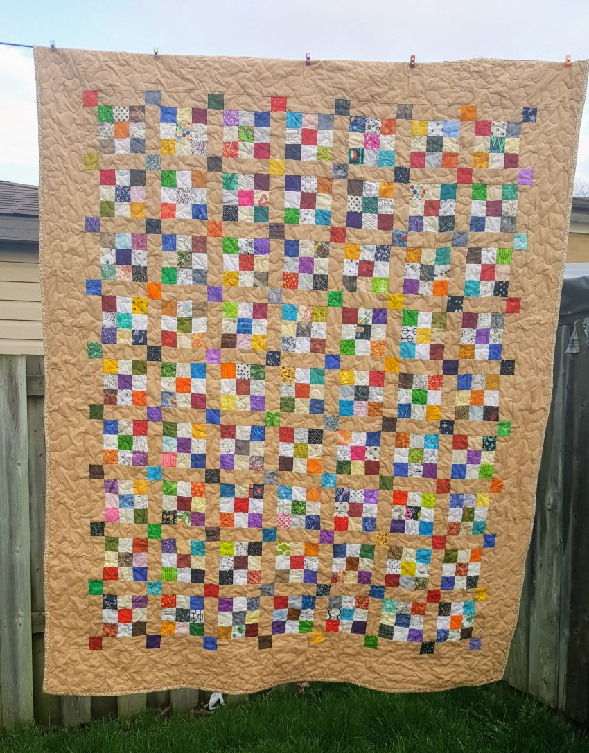 finished 9 patch and beige quilt